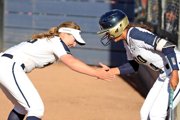 Coach Amanda Buck operates her Elk Grove High softball team like a finely-crafted marketing plan.