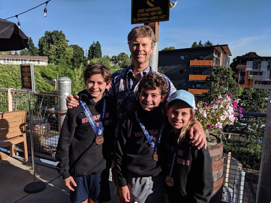 Sofie with Michael Solomon (left), who dove in the Boys 12-13 age group in both the 1 meter and 3 meter springboard events, placing 7th on 3m and 6th on 1m. and brother Jake Solomon who competed in the Boys 11 & Under 1 meter event, placing 7th.